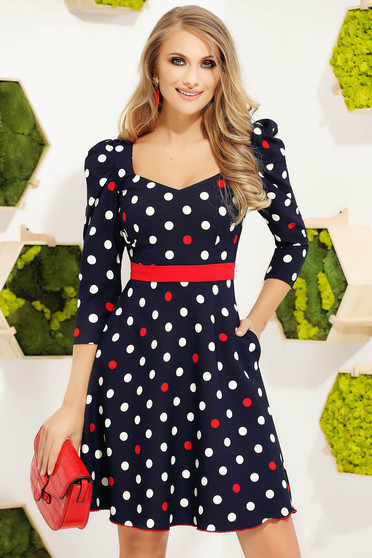 Red dress elegant short cut cloche accessorized with belt high shoulders dots print