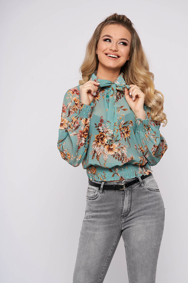 Turquoise women`s blouse casual long sleeve flared short cut from veil fabric with floral print
