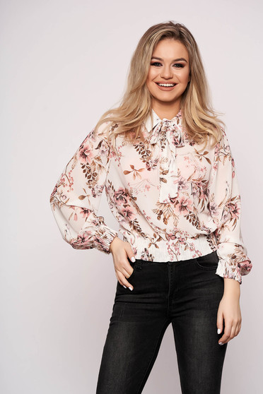 White women`s blouse casual long sleeve flared short cut from veil fabric with floral print
