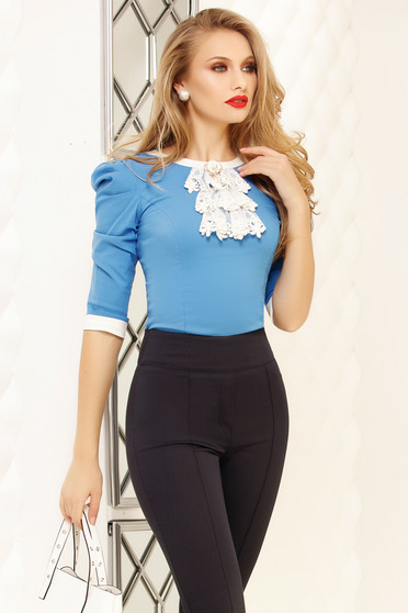 Blue women`s shirt office accessorized with breastpin high shoulders tented short cut cotton